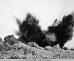 Japanese shell explodes near a U. S. position.