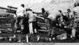 .105 mm gun and crew on Attu