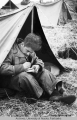 Private Oliver Delorio of San Francisco writing a note