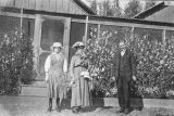 Fairbanks Station 1917. Mr. J. W. Neal, wife and daughter in front of Station cabin.