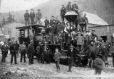 Men and boys gathered around a train locomotive.