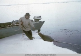 Edward Kiokun (Qiuran) hauling a seal out of the water