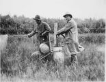 July 10, 1931. Spraying quack grass with sodium chlorate on [Soundon's?] farm in Matanuska valley....