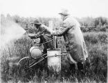 July 10. Spraying quack grass with sodium chlorate on farm in Matanuska Valley. Matanuska Station...