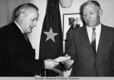 Gov. Egan receives a check
