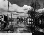 Chena River flood - First and Dunkel Streets, looking north, Fairbanks, 1948.