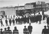 Deutch band parading First Avenue.  Iditarod City, March 9th, 1912.