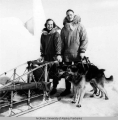 Rowland and Mary Cox behind a dog sled
