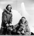 Rowland and Mary Cox posing with sled dogs