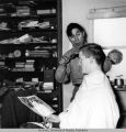 Rowland Cox getting a haircut from Donald Oktollik