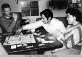 Rowland Cox playing Monopoly