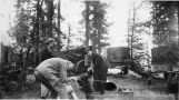 Canol workers playing with bear cub.