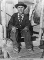 Elderly man sitting on wooden steps