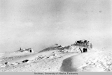 Sod houses w/snowblock stormsheds in drifting snow