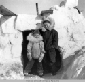 Two children at snowblock stormshed entrance