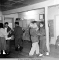 Adolescents dancing in schoolhouse.