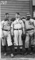 Three baseball players posing
