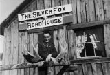 Man standing in front of Silver Fox Roadhouse.