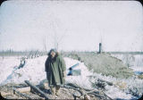 Nora Black in front of her sod house at Shungnak.