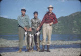 Chester Cone, Eskimo guide, and Quentin Crabaugh with lake trout.