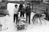 Jeffrey Nickoli, Adolf McGinty, Lenny Nickoli delivering firewood to elders.