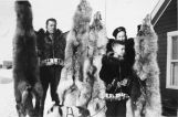 Frank Whaleys [family] with wolf pelts.