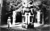 Ruth Dallas Crawford Brownell and the Saanaheit Totem pole and house poles in Kasaan, Alaska.
