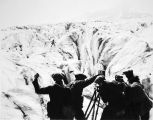"Cameramen filming a scene for the 1923 movie ""The Cheechakos"" on a glacier."
