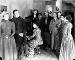 "Actors and actresses from the 1923 film ""The Cheechakos"" during a scene."