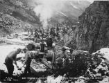 Rock crusher in operation, supplying stones for concrete work for bridge 70. Oct. 8/1919.