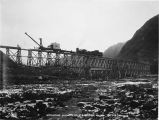 Removing old trestle @ bridge No. 75. Oct. 8/1919.