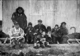 Some Eskimos on Siberian shore with our engineer.
