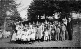 Group of mission children and workers. K[odiak] B[aptist] O[rphanage], Alaska.