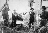 James Muir with moose heads.