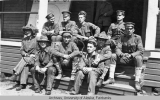 Group of soldiers sitting on porch steps