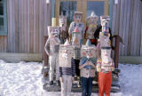 Students wearing paper bag masks.