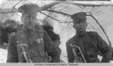 Two soldiers holding trumpets