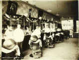 Barbers at Comet Barbershop.