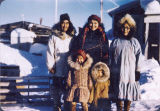 Group of people wearing parkas.