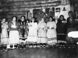 Singing Inupiaq hymns in church.