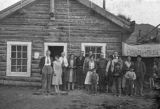 Group of people in front of Wiseman roadhouse.