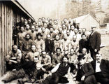 Group of men (cannery workers?) posing for a photograph.