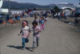 Children running in Kaltag.