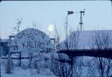 "Sign reading ""Welcome to Kaltag - 1980""."