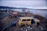 Yukon River - cars and firewood on foreground.