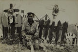 Frank Luke at Old Sam and Old Belle Sam's grave at Sam Point on the Healy River, circa 1950.