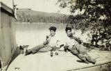 Arthur Healy and Silas Solomon relaxing aboard a boat on the Tanana River, circa 1940.