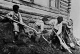Boys digging with shovels in the garden at Tanacross, date unknown.