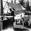 Matthew Paul at camp at Dog Lake (near Northway), 1936.