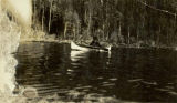 Arthur Healy in a canoe on George Lake, circa 1940s.